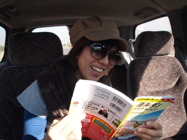 Minako checks out her Japanese guidebook
