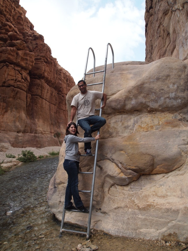 Zeynap and Emre climb the ladder out of Mujib Nature Preserve