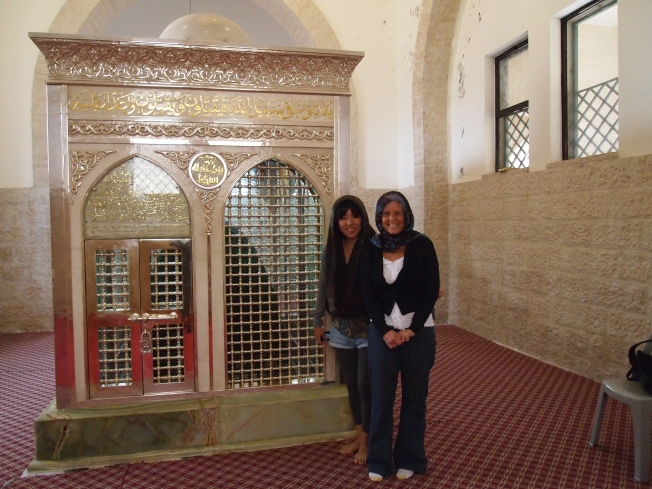 Minako and me in headscarves next to the enshrined martyr ~ before the 1 dinar extortion