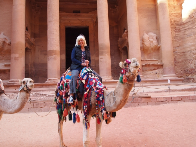 on a camel in front of the Treasury