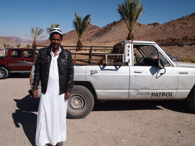 Our guide at Wadi Rum and his Nissan pickup truck