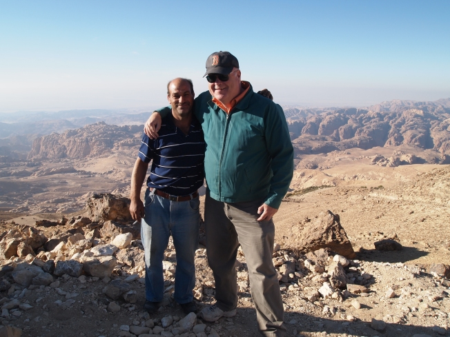 Hussen, Atef's brother and our driver to Wadi Rum, and my colleague Matt on the overlook to Petra