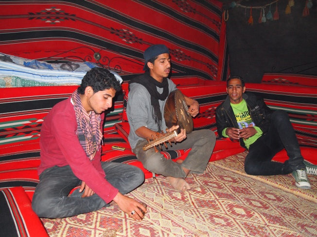 the Bedouin boys playing music at Seven Wonders Bedouin Camp
